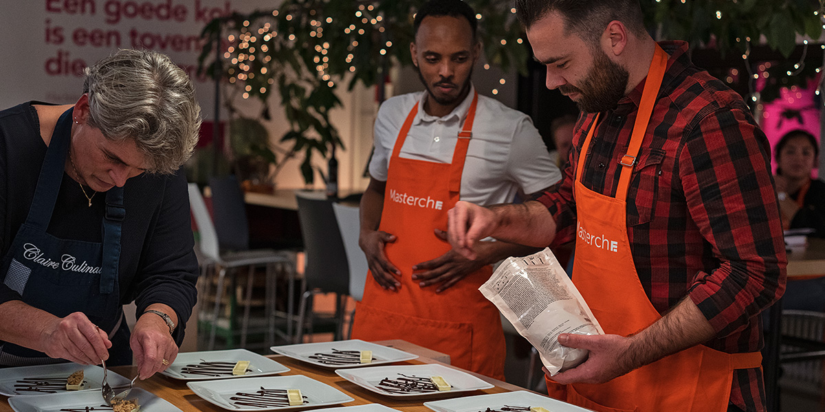 Ahmed and Sjef during a cooking workshop